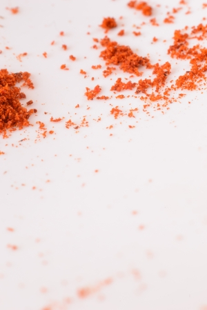 Detail of heap red pepper on the white.