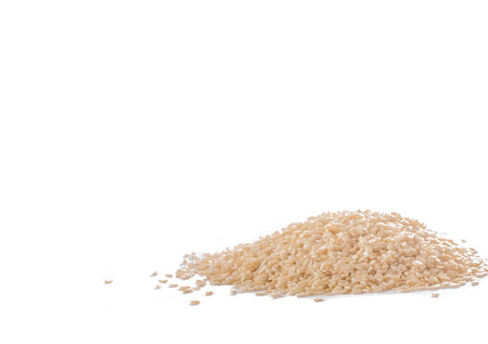 Detail of heap of sesame on white background