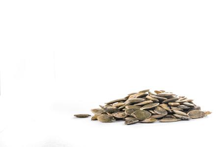 Detail of heap of pumpkin seed on whte background  Standard-Bild