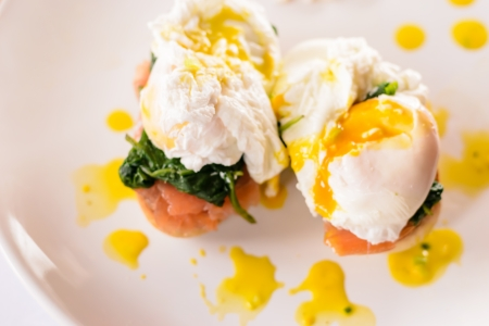 Detail of delicious Benedict egg. Close up Creative food.