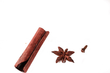 Detail of cinnamon, clove and badian on white background. Close up. Stock Photo