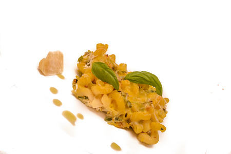 Detail of delicious food vegetarian food baked pasta with parmesan, close up, creative food with basil. White background.