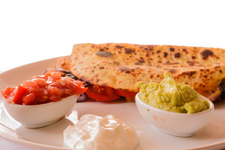 Detail of delicious Chicken quesadilla on white background.