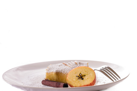 Detail of delicious apple studel on white background with badian, cinnamon and clove.