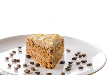 Detail of delicious coffe cake  Close up on white background  Stock Photo