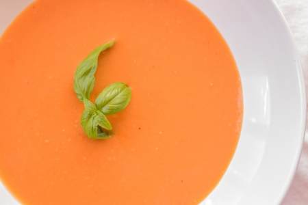 Detail of delicious tomato soup on white background  Stock Photo