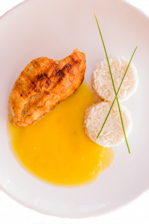 Detail of healthy food Chicken with pumpkin soup on white backround  Stock Photo