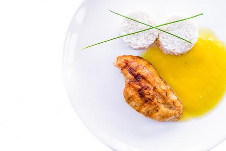 Detail of healthy food Chicken with pumpkin soup on white backround  Standard-Bild