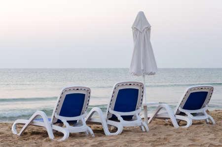 sunbeds: Sunbeds on the beach with a umbreluta next Stock Photo