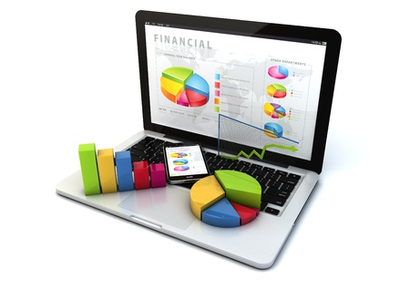 desarrollo econ�mico: hacen de una computadora port�til y un smartphone con aplicaci�n financiera en la pantalla, y algunos gr�ficos sobre el teclado Foto de archivo