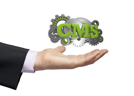 cms: gears with text cms over a businessman hand Stock Photo