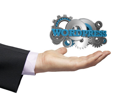 wordpress: gears with the text wordpress over a businessman hand