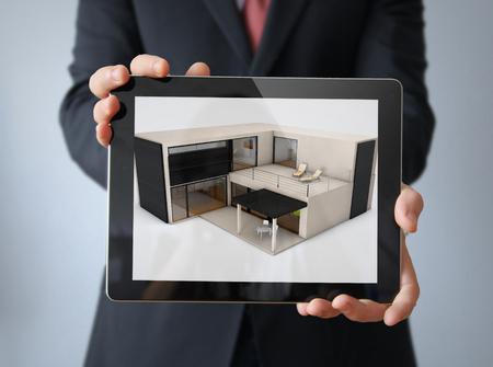modular: architecture concept: modular concrete house design on a businessman tablet Stock Photo