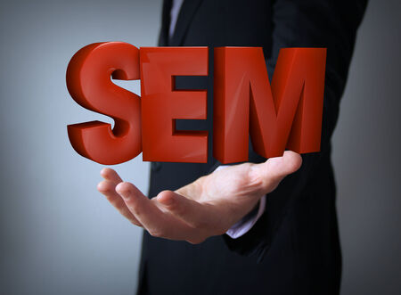 metasearch: search engine marketing concept: sem word over businessman hand