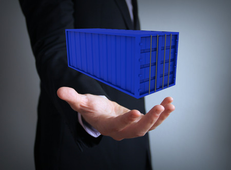 container over businessman hand photo