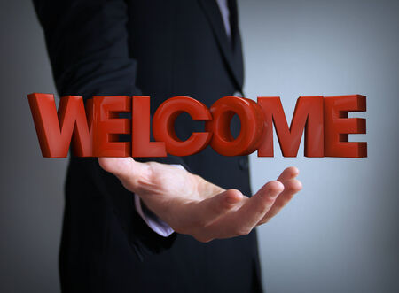 welcome text over businessman hand photo