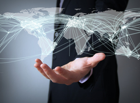 logistics world: air traffic concept: world connections map over businessman hand Stock Photo