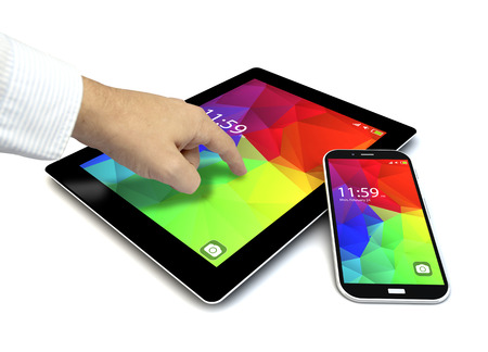 touchscreen tablet,  and smartphone with colorful interface with color icons and buttons and a hand touching the screen isolated on white background photo