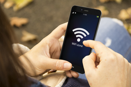 connectivity concept: wifi zone sign on phone screen Stock Photo