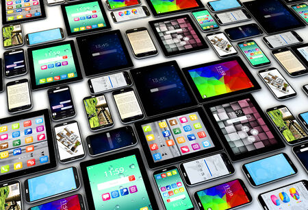 Creative abstract mobility and digital wireless communication concept: group of tablet PC and modern smartphones or mobile phones photo