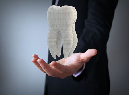 dental technician: businessman with 3d facet tooth Stock Photo