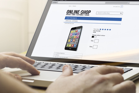 trackpad: home e-commerce concept: man using a laptop to go shopping Stock Photo