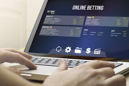 addiction concept: using the computer to online betting Фото со стока