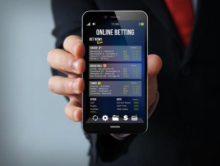 Glücksspiel-Konzept: Geschäftsmann Hand, die eine Touch-Handy mit bet App