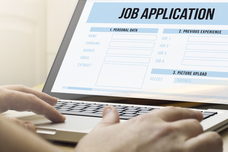 online form: job search concept: man using a laptop with job application on the screen