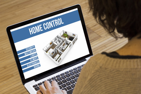smart home: remote control home automation online concept: smart home remote control software on a laptop screen