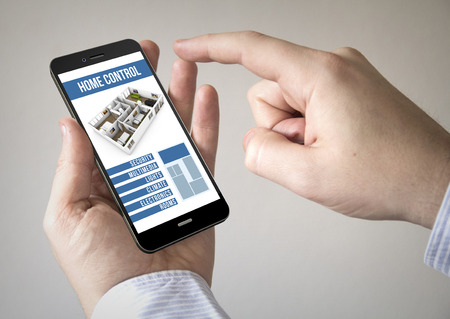 mobile home: Close up of man using mobile smart phone with smart home control app on the screen