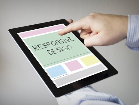 new technologies: new technologies concept: hands with touchscreen tablet with responsive design wireframe
