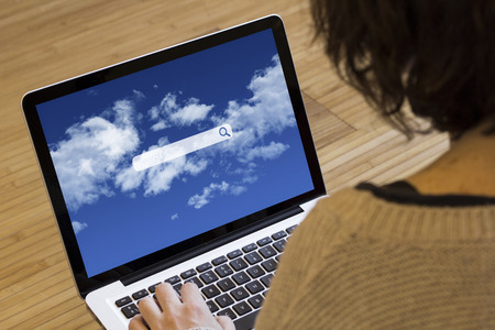 search query: search online concept: search application on a laptop screen Stock Photo