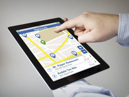 new technologies: new technologies concept: hands with touchscreen tablet with restaurant search. All screen graphics are made up.