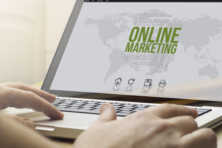 online business concept: man using a laptop with online marketing on the screen. Screen graphics are made up. Stock Photo