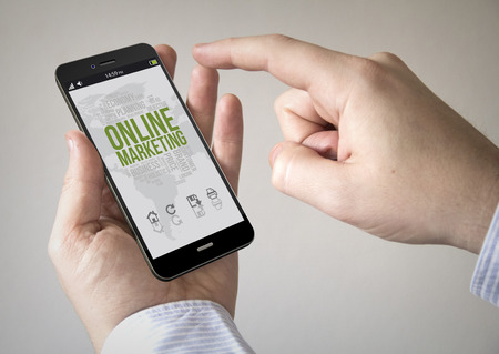 mobile marketing: Close up of man using 3d generated mobile smart phone with online marketing on the screen. Screen graphics are made up.