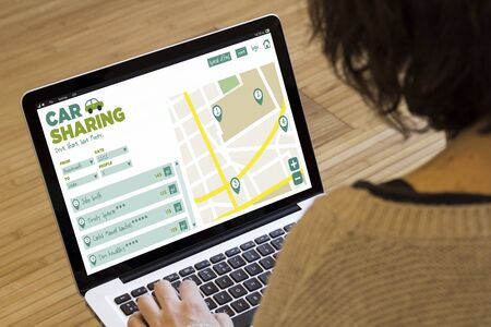 social travel concept: car sharing software on a laptop screen. Screen graphics are made up. Stock Photo