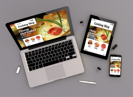 BLOG: 3d render of coocking blog responsive devices with laptop computer, tablet pc and touchscreen smartphone. top view. All screen graphics are made up.