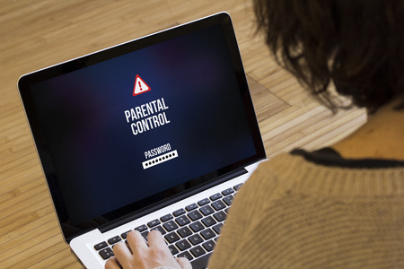 parental: chils safety concept: parental control on a laptop screen. Screen graphics are made up. Foto de archivo