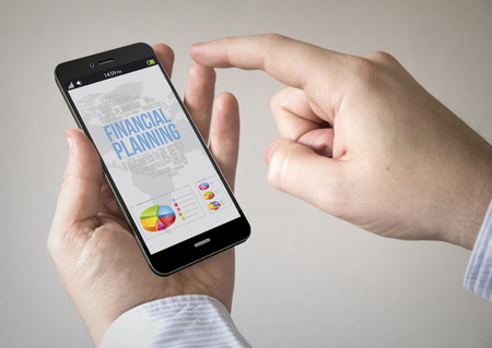 smart phone: Close up of man using 3d generated mobile smart phone with financial planning on the screen. Screen graphics are made up.