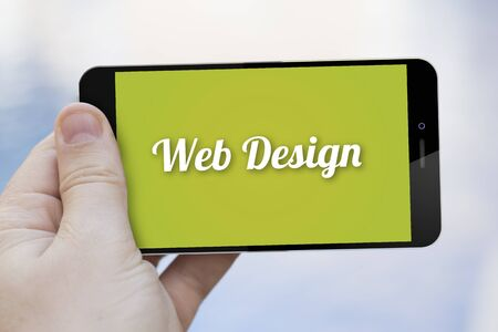 web screen: communications and marketing concept: hand holding a web design 3d generated smartphone. Screen graphics are made up. Stock Photo