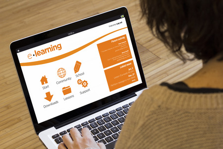 online education and training concept: e-learning platform on a laptop screen. Screen graphics are made up.