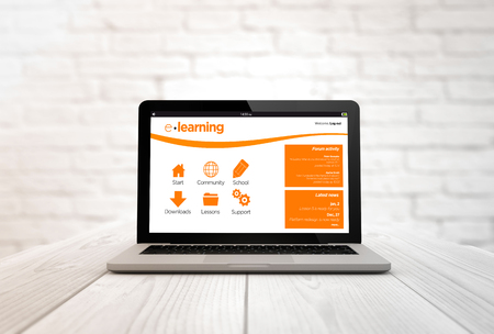 briks: education concept: digitally generated laptop on a wooden table with blank screen. Screen graphics are made up.