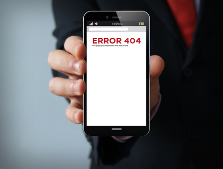 disconnection: disconnection concept: businessman hand holding a 3d generated touch phone with error 404 on the screen. Screen graphics are made up.