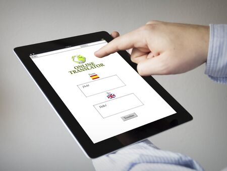 new technologies: new technologies concept: hands with touchscreen tablet with online translator on the screen. Screen graphics are made up.