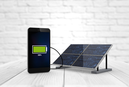 pannel: digital generated smart phone charging with solar pannel. Screen graphics are made up. Stock Photo