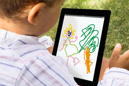 tab: Kid drawing with tablet app