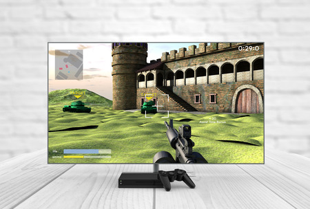 Computer gaming and entertainment technology concept: 3d generated lcd television, gamepad and game console with shooter game on the screen. All graphics are made up. Stock Photo