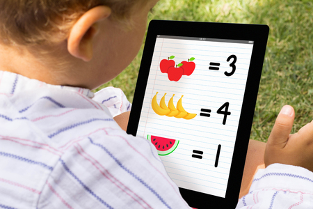 tab: Kid playing and learning with tablet