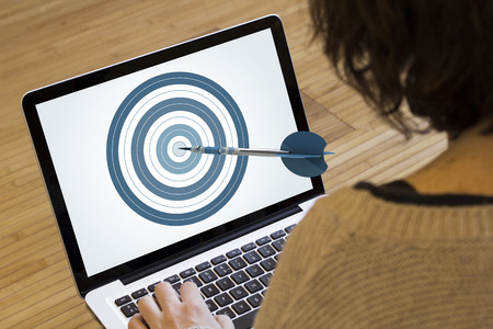 marketing target: marketing online concept: dartboard and target on a laptop screen. Screen graphics are made up.